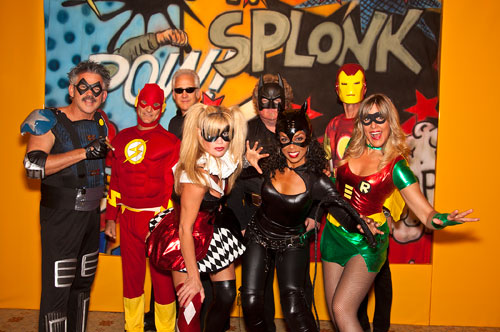 The Zippers band members pose in super hero costumes.